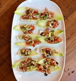Endive cups filled with tomato jicama salad