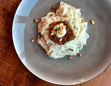 Rice noodles with zucchini fritters and fried pine nuts